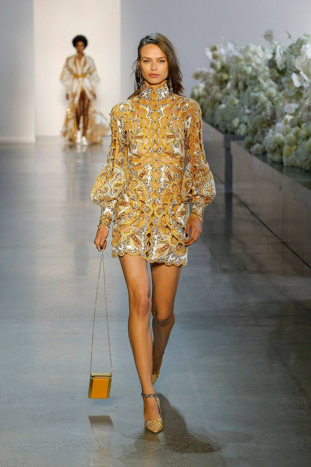 Zimmermann Ready To Wear Spring 2019 Look 1 zippy scallop mini dress in golden paisley paisley pump in golden paisley cigarette case in oro 1